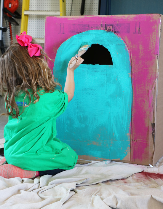 Painting a cardboard house