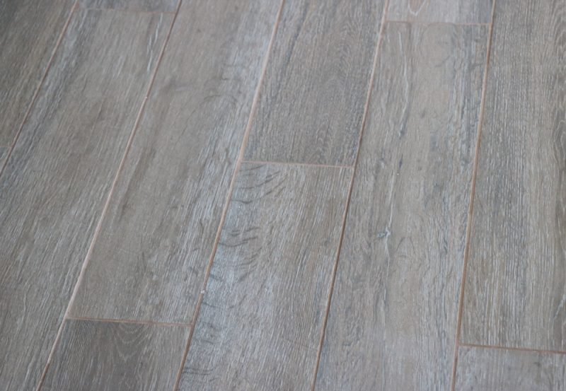 Bathroom remodel south cypress tile sincerely sara d it has dynamic grain patterns and cross cut texturing exquisitely mimicking the the intricacies of vintage faded hardwood the tile is italian made and ppazfo